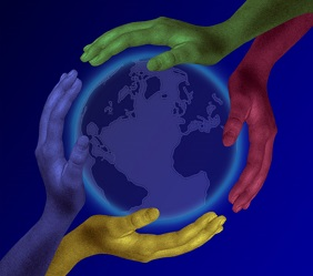 multi colored hands encircle earth globe