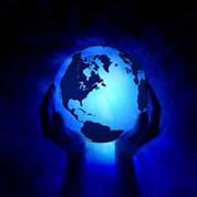 Hands holding glowing blue earth