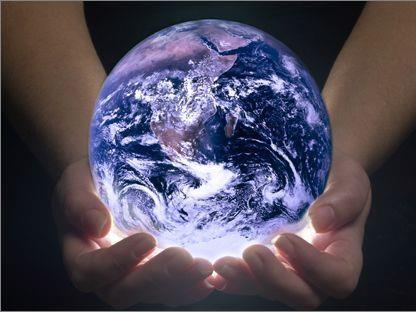 hands holding glowing earth