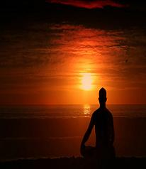 Bright orange sunset and meditation