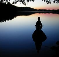 Peacefull meditation in front of lake