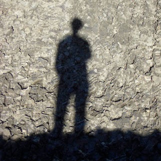 Physical body of man shadow on wall